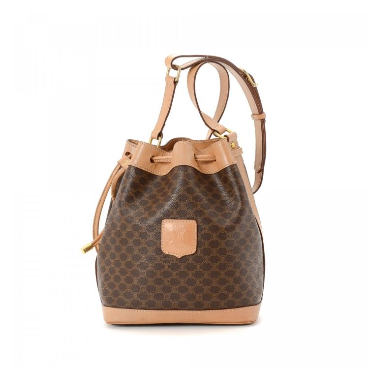 LXRandCo guarantees this is an authentic vintage Céline Bucket Bag shoulder  bag. This everyday shoulder bag in beautiful brown is made in macadam  coated ... 02aa6ce938eba