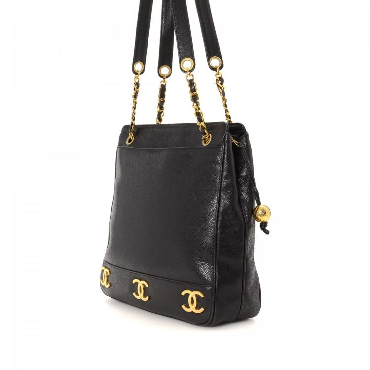 91b7eb7bac6abf LXRandCo guarantees this is an authentic vintage Chanel Signature Gold  Triple CC Logo Shopping Bag shoulder bag. This luxurious shoulder bag was  crafted in ...