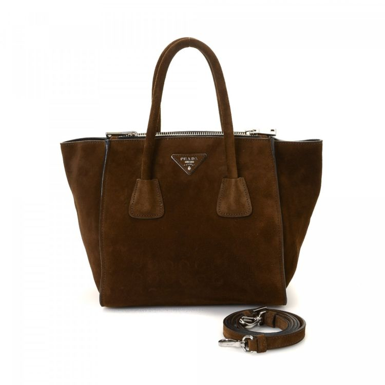 54509ea737 LXRandCo guarantees the authenticity of this vintage Prada Two Way handbag.  This practical purse comes in beautiful dark brown suede.