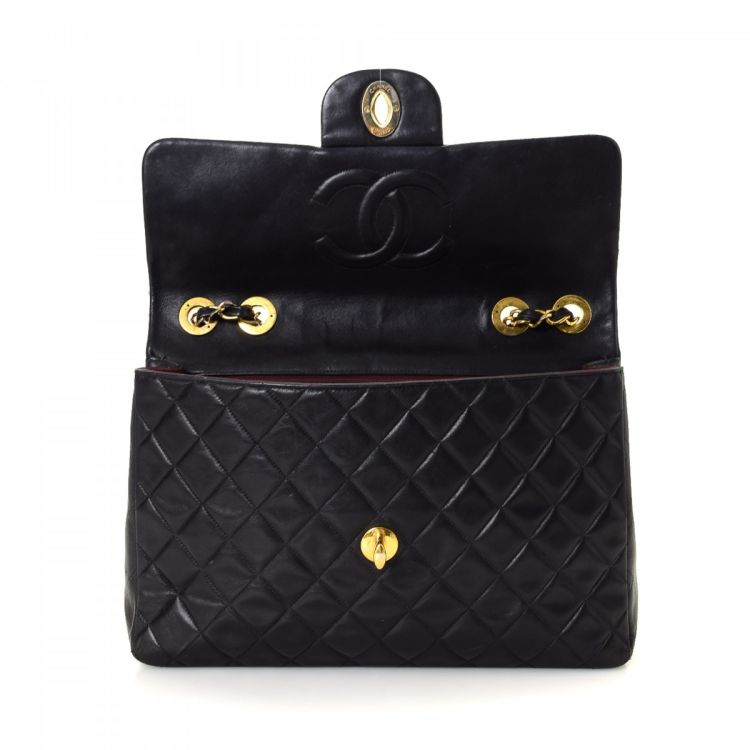 c33c85af25438f LXRandCo guarantees this is an authentic vintage Chanel Maxi Classic Flap  Bag shoulder bag. This elegant bag was crafted in lambskin in black.