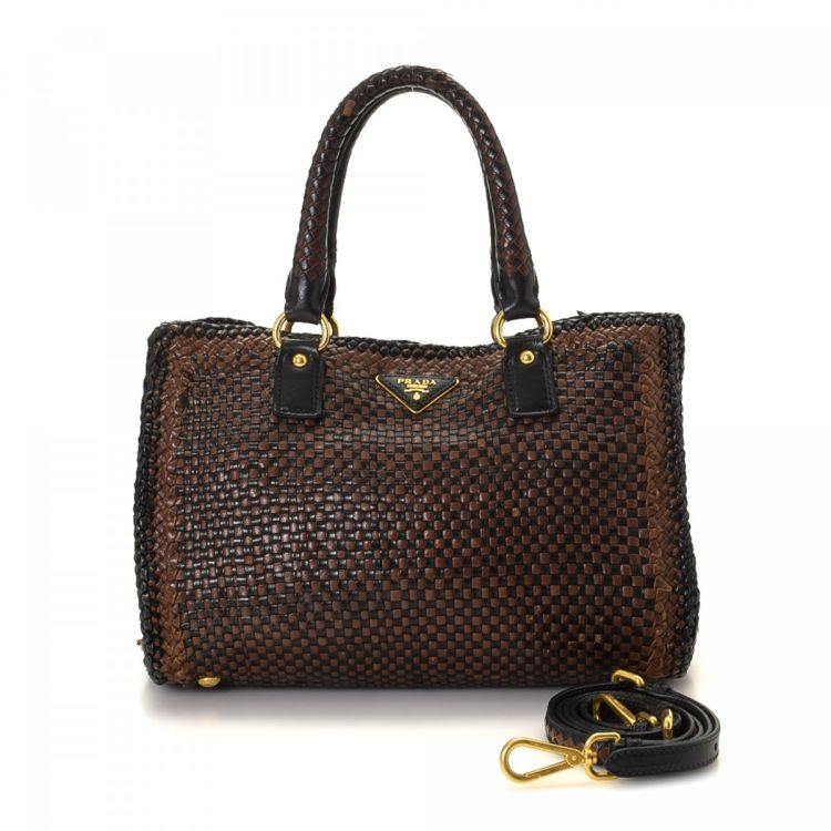 b8203fcbb564 LXRandCo guarantees the authenticity of this vintage Prada Madras shoulder  bag. This beautiful bag was crafted in leather in brown.