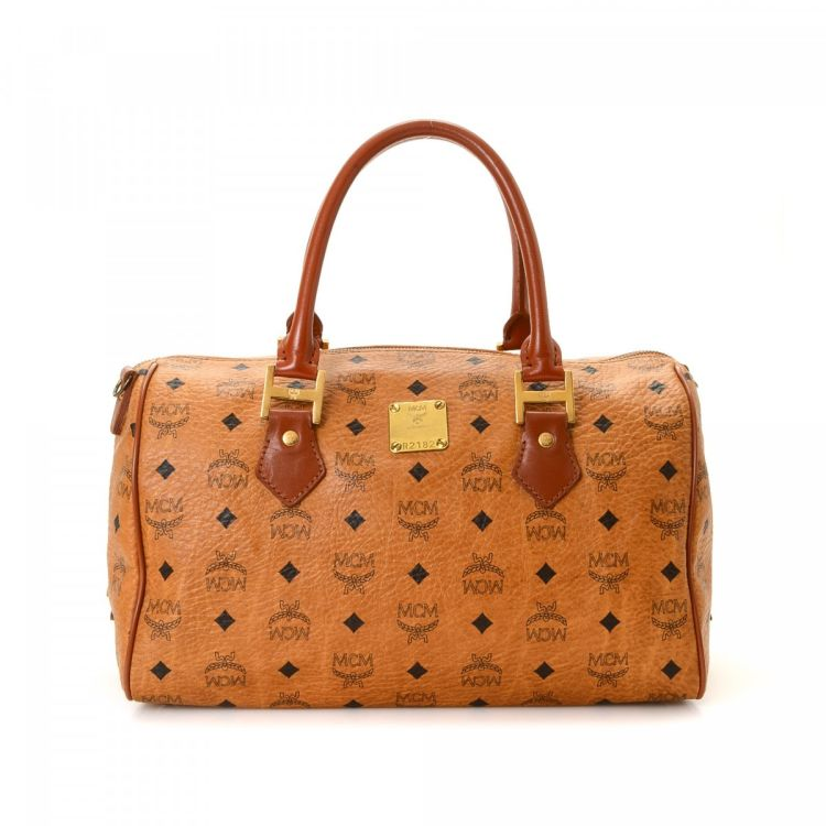 39368e0b5 LXRandCo guarantees this is an authentic vintage MCM Boston Bag travel bag.  Crafted in visetos leather, this chic carry-on comes in cognac.