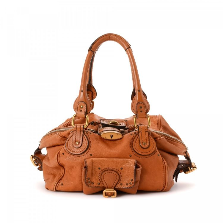 eecb188b20d5 LXRandCo guarantees this is an authentic vintage Chloé Paddington handbag.  This sophisticated bag was crafted in leather in brown. Due to the vintage  nature ...