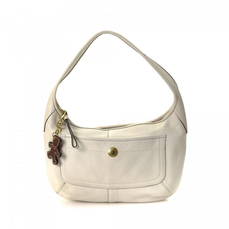 LXRandCo guarantees the authenticity of this vintage Coach shoulder bag.  Crafted in leather 89c30a451f129