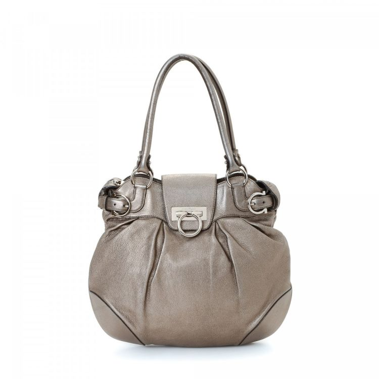 bcee76812bea LXRandCo guarantees this is an authentic vintage Ferragamo shoulder bag.  This classic purse in beautiful metalic bronze is made in gancini leather.