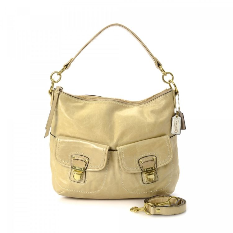 6e867545c06acf LXRandCo guarantees this is an authentic vintage Coach Poppy Swing shoulder  bag. This sophisticated pocketbook comes in gold tone leather.