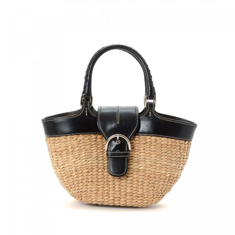77b10821897 LXRandCo guarantees the authenticity of this vintage Coach handbag. Crafted  in raffia