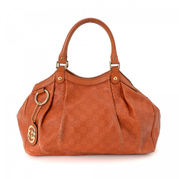 78a253ea84ff06 The authenticity of this vintage Gucci Sukey Tote Bag shoulder bag is  guaranteed by LXRandCo. This stylish bag in orange is made in guccissima  leather.
