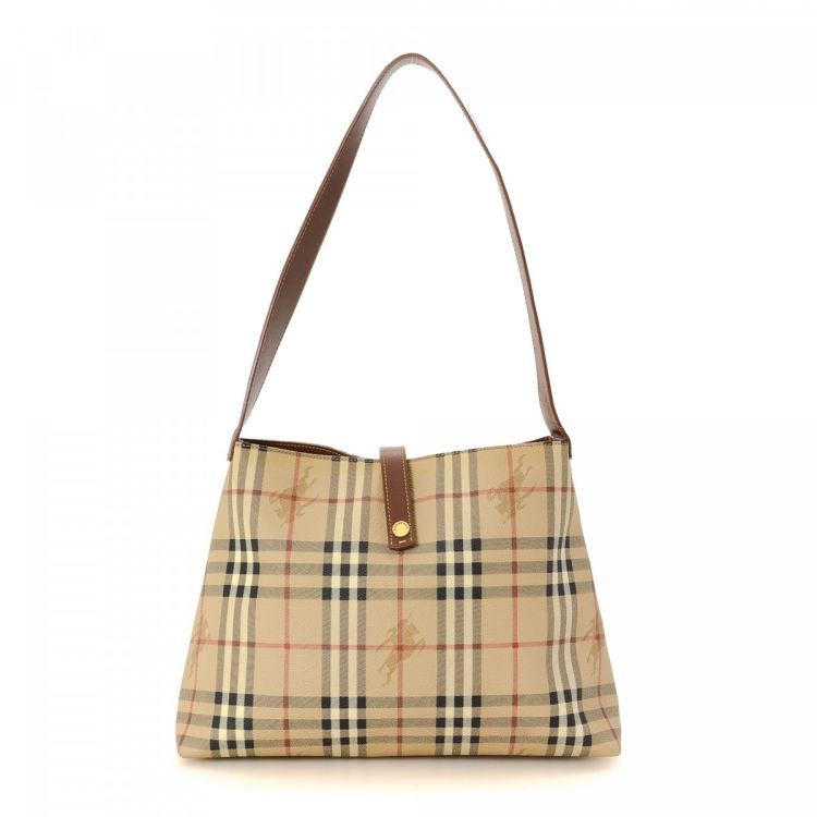 dc608f6edf0b LXRandCo guarantees the authenticity of this vintage Burberry shoulder bag.  Crafted in leather