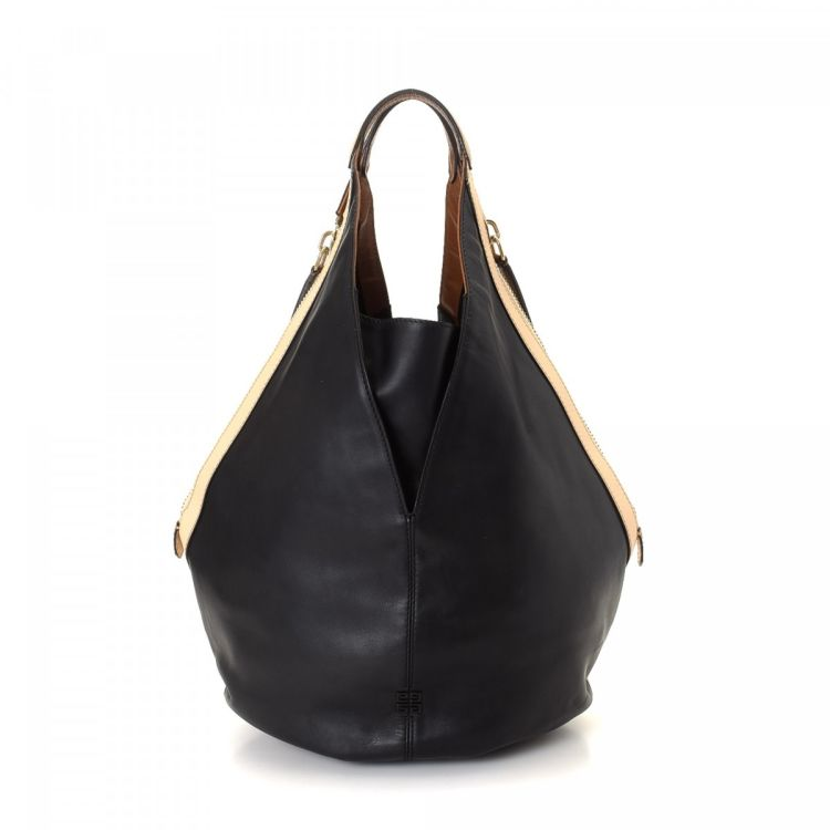 9fc037de55 The authenticity of this vintage Givenchy Tinhan Hobo Bag shoulder bag is  guaranteed by LXRandCo. This sophisticated purse was crafted in leather in  black.