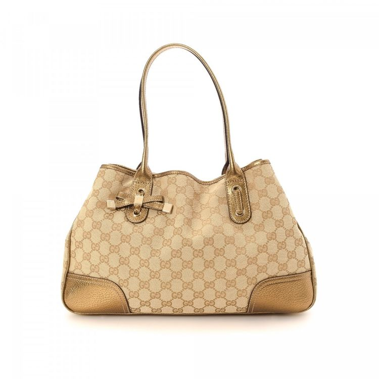 68df7a7d6 The authenticity of this vintage Gucci Princy Bag tote is guaranteed by  LXRandCo. This chic large handbag in beautiful beige is made in gg canvas.