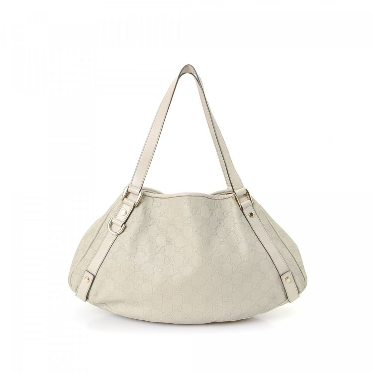 c4b4ad25eade5d LXRandCo guarantees the authenticity of this vintage Gucci Abbey Tote  shoulder bag. This luxurious bag was crafted in guccissima leather in white.