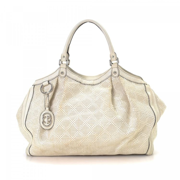 b7f9e77e726df6 LXRandCo guarantees this is an authentic vintage Gucci Sukey tote. This  sophisticated bag was crafted in diamante leather in white.