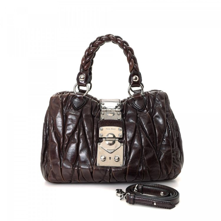 3113964c4a8d LXRandCo guarantees the authenticity of this vintage Miu Miu Two Way Bag  handbag. This signature pocketbook was crafted in matelasse leather in  beautiful ...