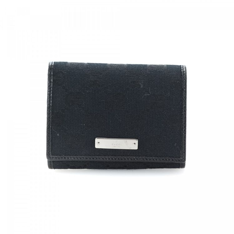 25a4a0c607b0 LXRandCo guarantees this is an authentic vintage Gucci Coin Purse wallet.  This practical bifold in beautiful black is made in gg canvas.
