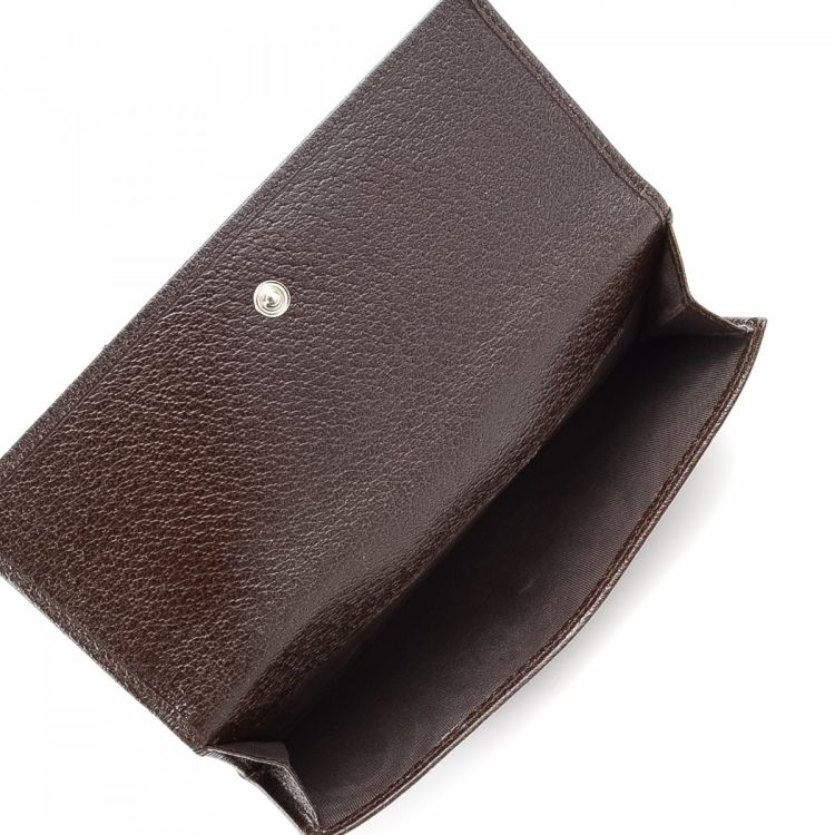 e1b3fb300773 The authenticity of this vintage Gucci Long wallet is guaranteed by LXRandCo.  Crafted in leather