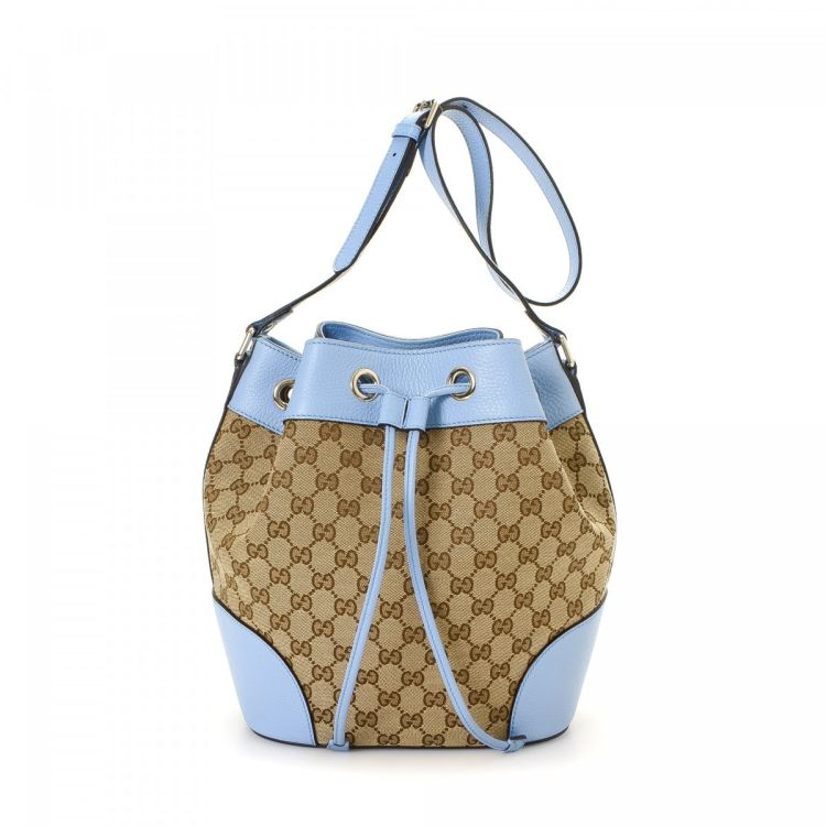 4dec425f211 LXRandCo guarantees the authenticity of this vintage Gucci Bucket Bag  shoulder bag. Crafted in gg canvas