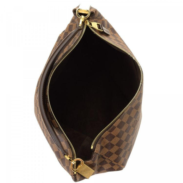 b346a86ea4c0 LXRandCo guarantees the authenticity of this vintage Louis Vuitton  Portobello PM handbag. This iconic purse was crafted in damier ebene coated  canvas in ...