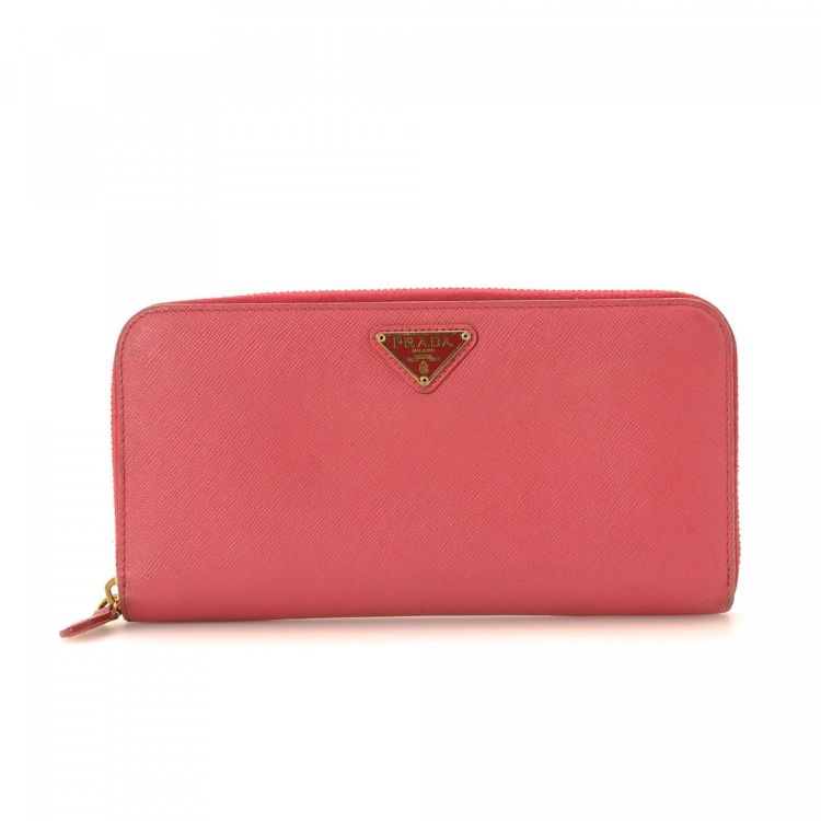 ed4c256abc14 LXRandCo guarantees this is an authentic vintage Prada Zip Around wallet.  This stylish compact wallet in beautiful pink is made in saffiano leather.