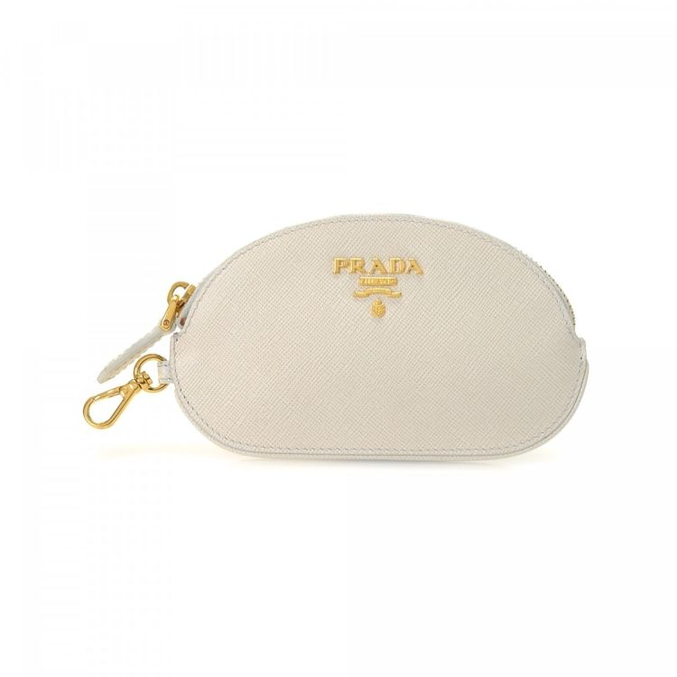a34b7e543aa1 LXRandCo guarantees the authenticity of this vintage Prada Pouch vanity  case & pouch. This elegant vanity case & pouch in white is made in saffiano  leather.