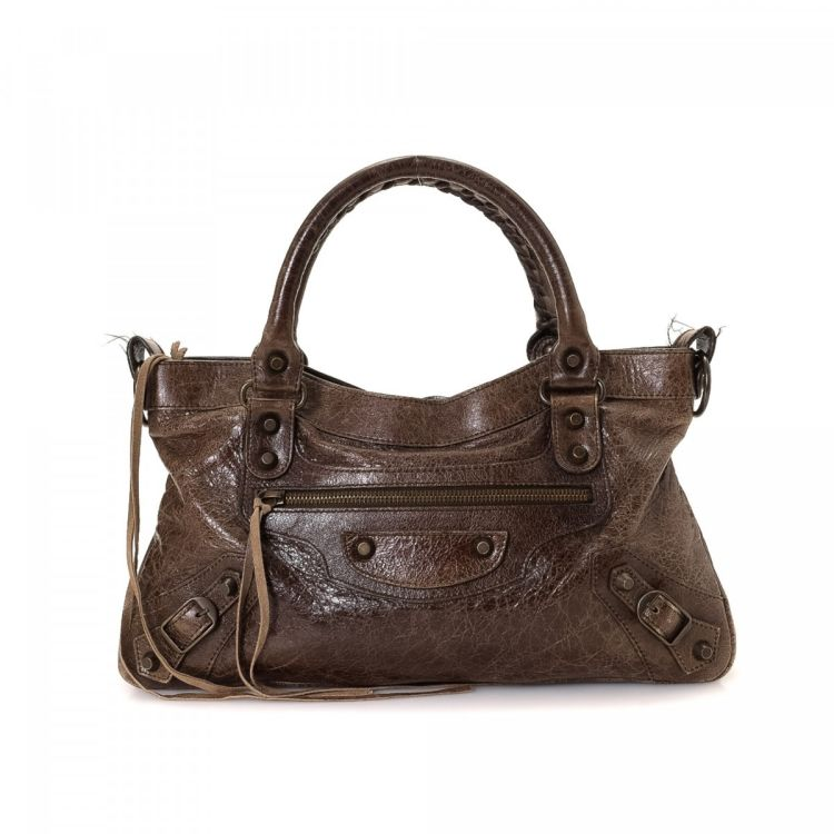 6208fd3c16ef The authenticity of this vintage Balenciaga First handbag is guaranteed by  LXRandCo. This elegant bag comes in dark brown leather. Due to the vintage  nature ...