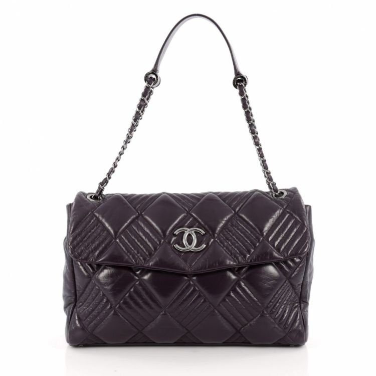 0c096bcb06d7bc The authenticity of this vintage Chanel In and Out Flap Bag Quilted Lambskin  Maxi handbag is guaranteed by LXRandCo. Iconic bag. Good condition* (AB)