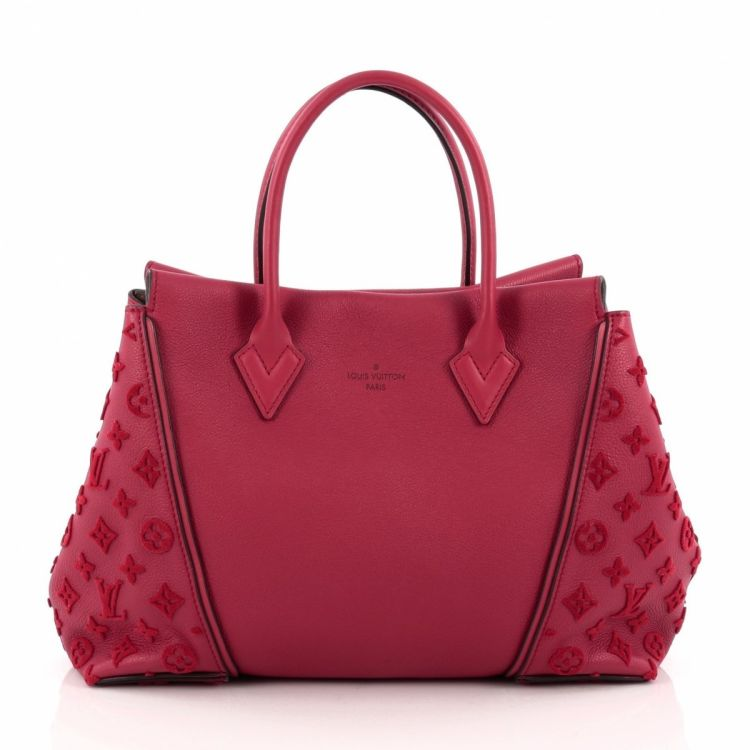 4065b389fc9f LXRandCo guarantees the authenticity of this vintage Louis Vuitton W Tote  Veau Cachemire Calfskin PM handbag. Crafted in monogram leather