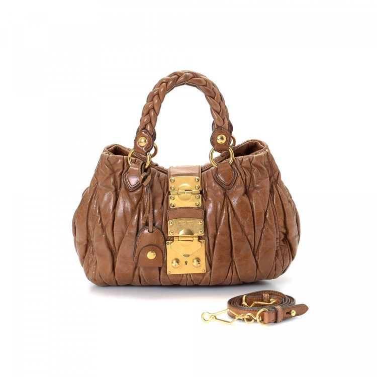 LXRandCo guarantees this is an authentic vintage Miu Miu Two Way Bag handbag.  Crafted in matelasse leather 8f13211073d9f