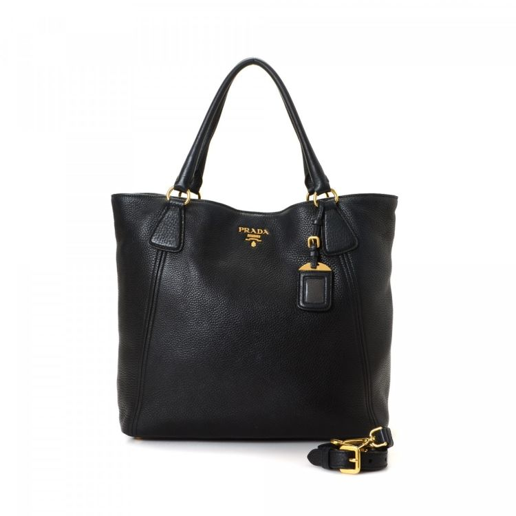 a6d8e335b9bd The authenticity of this vintage Prada Two Way Bag handbag is guaranteed by  LXRandCo. This lovely purse in beautiful black is made in vitello leather.