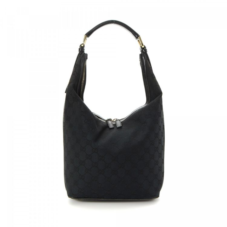bc615b1fe LXRandCo guarantees this is an authentic vintage Gucci Hobo Bag shoulder bag.  This beautiful shoulder bag in black is made in gg canvas.