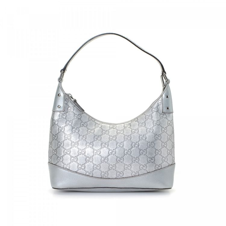 ec6a570d505 The authenticity of this vintage Gucci shoulder bag is guaranteed by  LXRandCo. This exquisite purse was crafted in guccissima leather in silver.