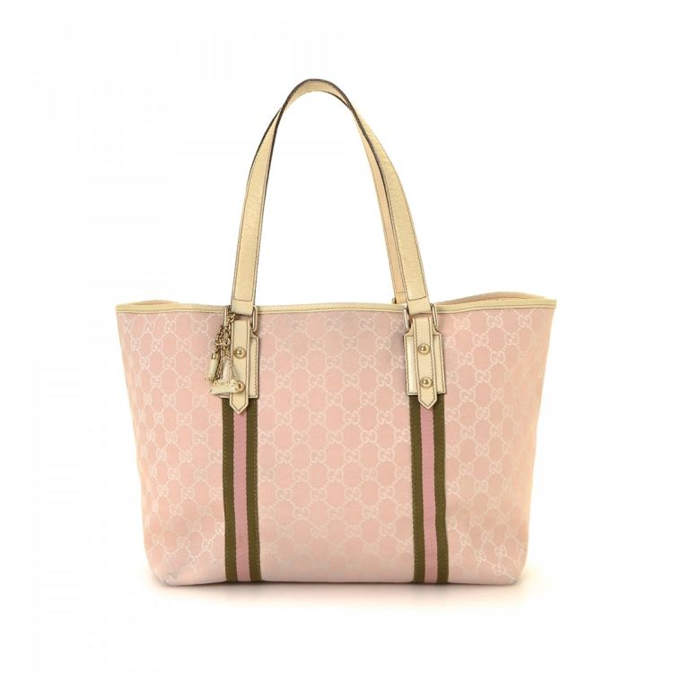 3d980d95f The authenticity of this vintage Gucci Jolicoeur tote is guaranteed by  LXRandCo. This sophisticated bag was crafted in gg canvas in baby pink.
