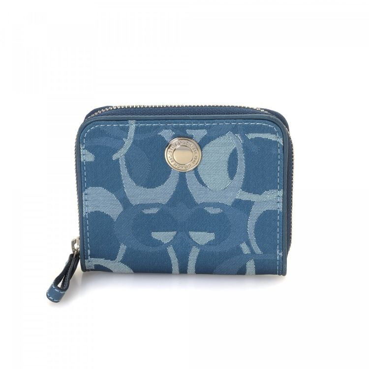 LXRandCo guarantees the authenticity of this vintage Coach Zip Around Coin  Purse wallet. This classic card holder was crafted in jacquard canvas in  blue. 09cffd96d1838