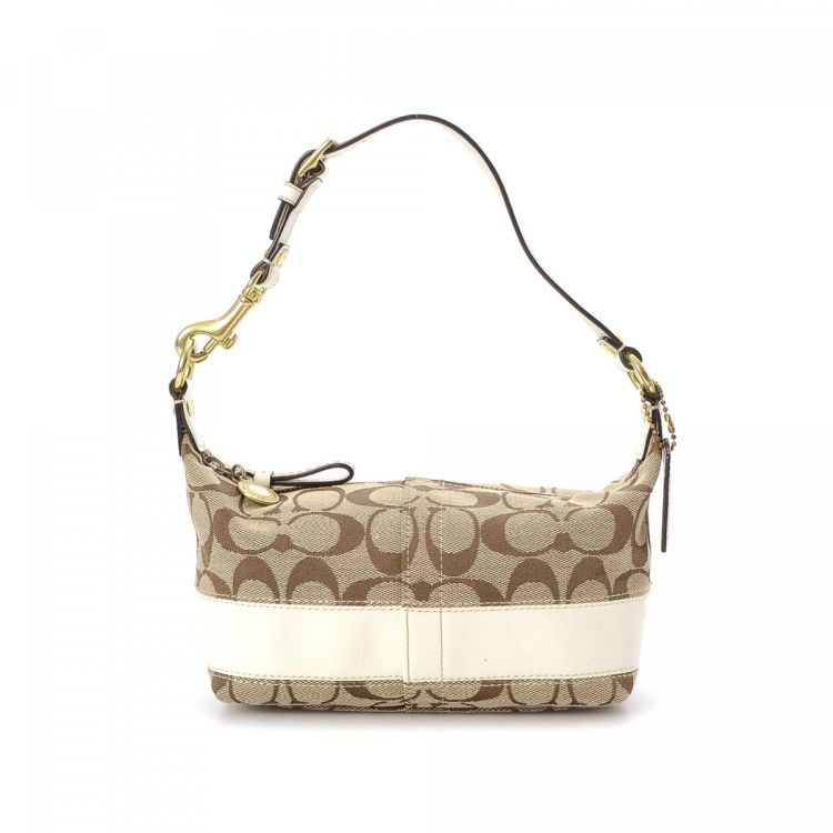LXRandCo guarantees the authenticity of this vintage Coach shoulder bag.  This iconic purse in beautiful beige is made in jacquard canvas. 9b3800a827ffa