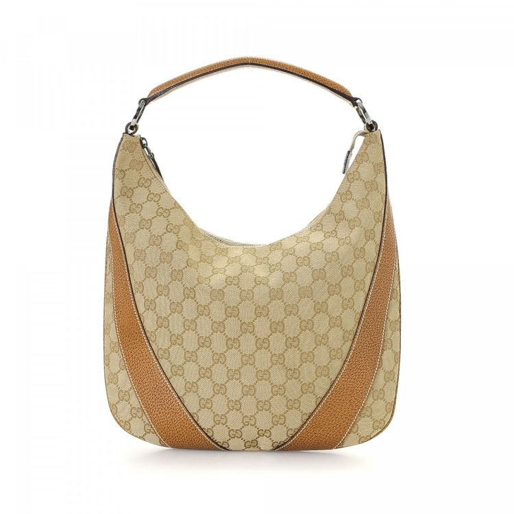 6ca353c8f4f The authenticity of this vintage Gucci GG Hobo Bag shoulder bag is  guaranteed by LXRandCo. This chic pocketbook in beautiful beige is made of  canvas.