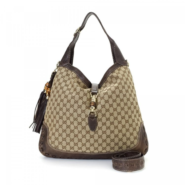 6c89ed37b8c1 The authenticity of this vintage Gucci New Jackie shoulder bag is  guaranteed by LXRandCo. This exquisite pocketbook was crafted in gg canvas  in beige.