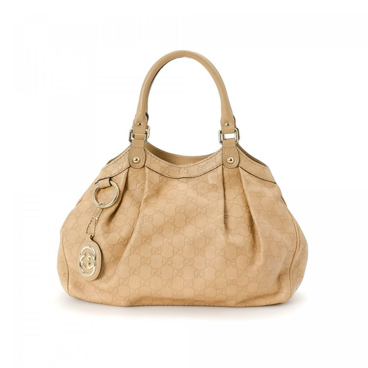 40fb79bfff88d8 The authenticity of this vintage Gucci Sukey Tote Bag handbag is guaranteed  by LXRandCo. This sophisticated bag was crafted in guccissima leather in ...