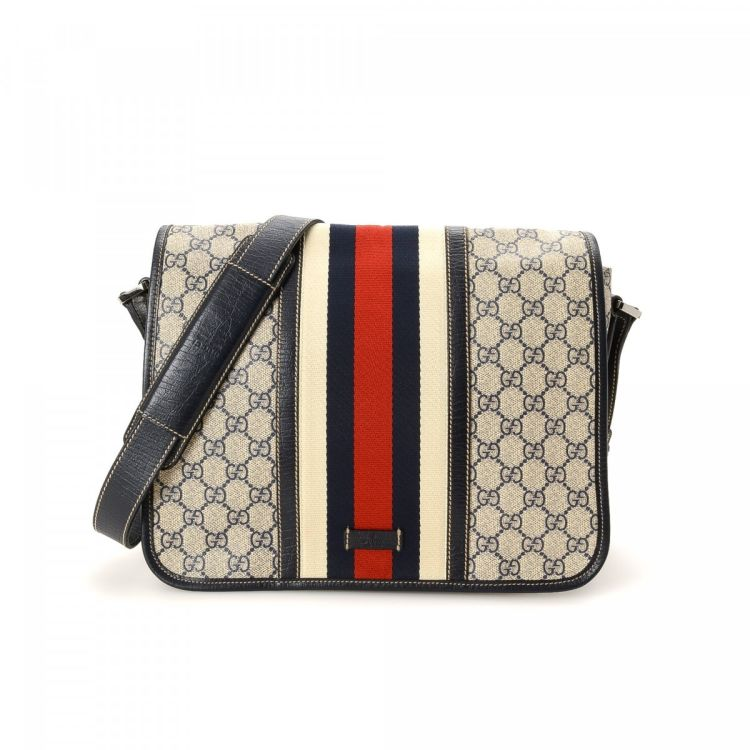 bd8046b90dc LXRandCo guarantees this is an authentic vintage Gucci Messenger Bag  messenger   crossbody bag. This refined pocketbook was crafted in gg supreme  coated ...