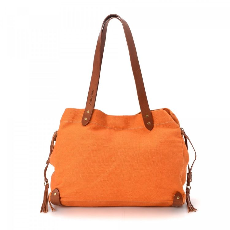 LXRandCo guarantees this is an authentic vintage Miu Miu tote. Crafted in  canvas ef099f35354e2