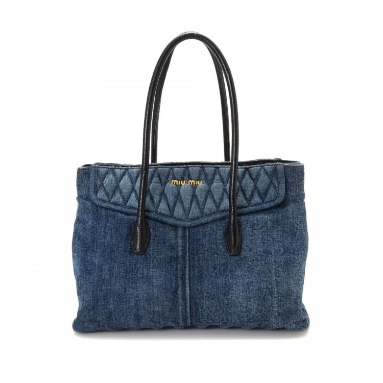 06df7c8e512ce LXRandCo guarantees the authenticity of this vintage Miu Miu tote. Crafted  in denim, this practical tote comes in blue. Due to the vintage nature of  this ...