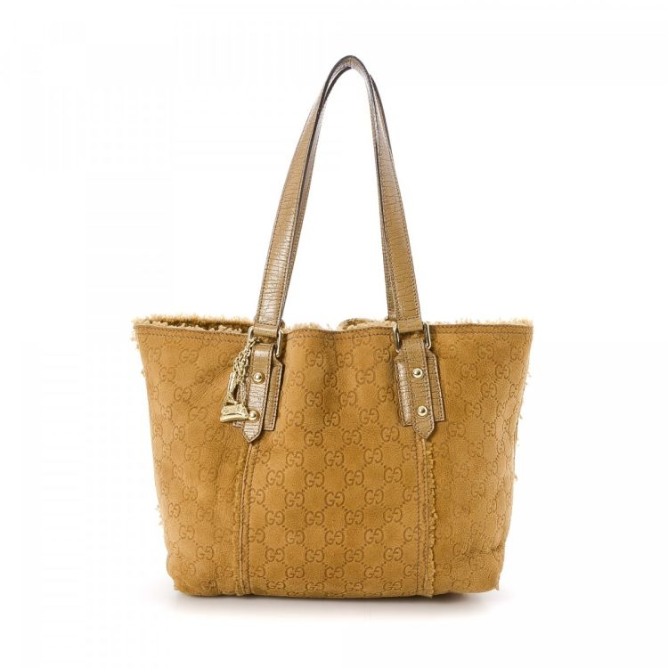 f8d40390e98 LXRandCo guarantees this is an authentic vintage Gucci Jolicoeur Bag tote.  This sophisticated tote was crafted in guccissima suede in beautiful  mustard.
