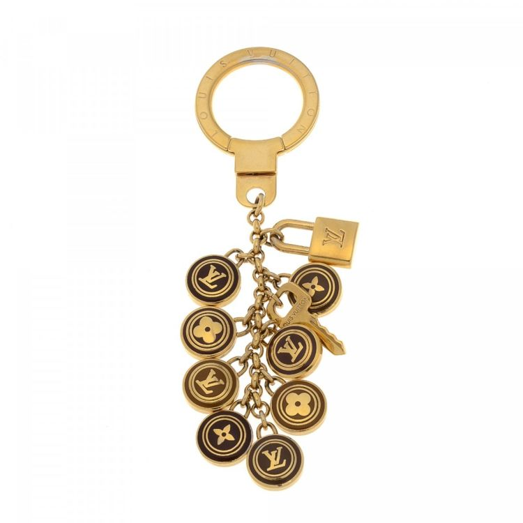 a6778ec01795 LXRandCo guarantees the authenticity of this vintage Louis Vuitton  Pastilles Bag Charm Key Holder key chain. Crafted in brass