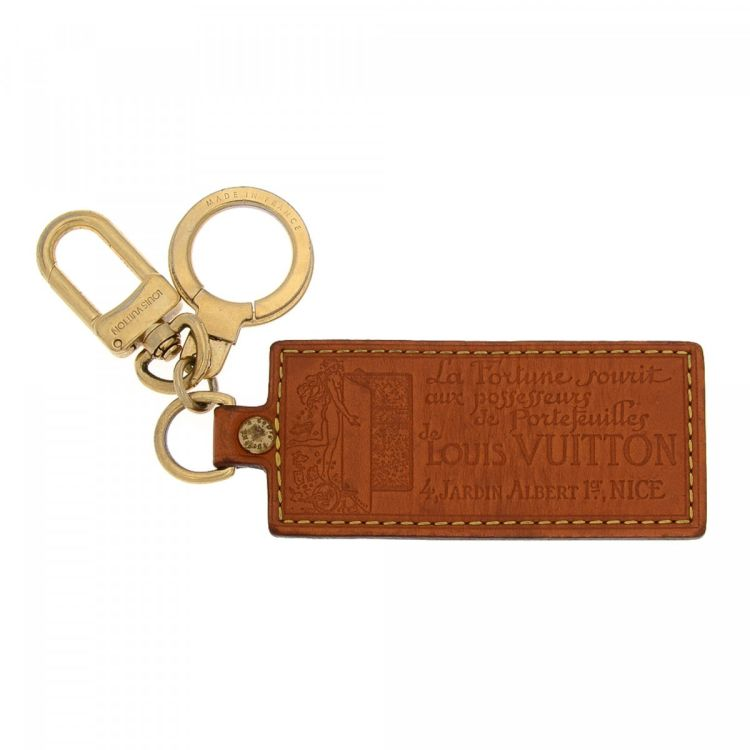 ef8ed7cffa8a LXRandCo guarantees the authenticity of this vintage Louis Vuitton La  Fortune Key Chain Bag Charm other accessory. This stylish accessory in  beautiful brown ...