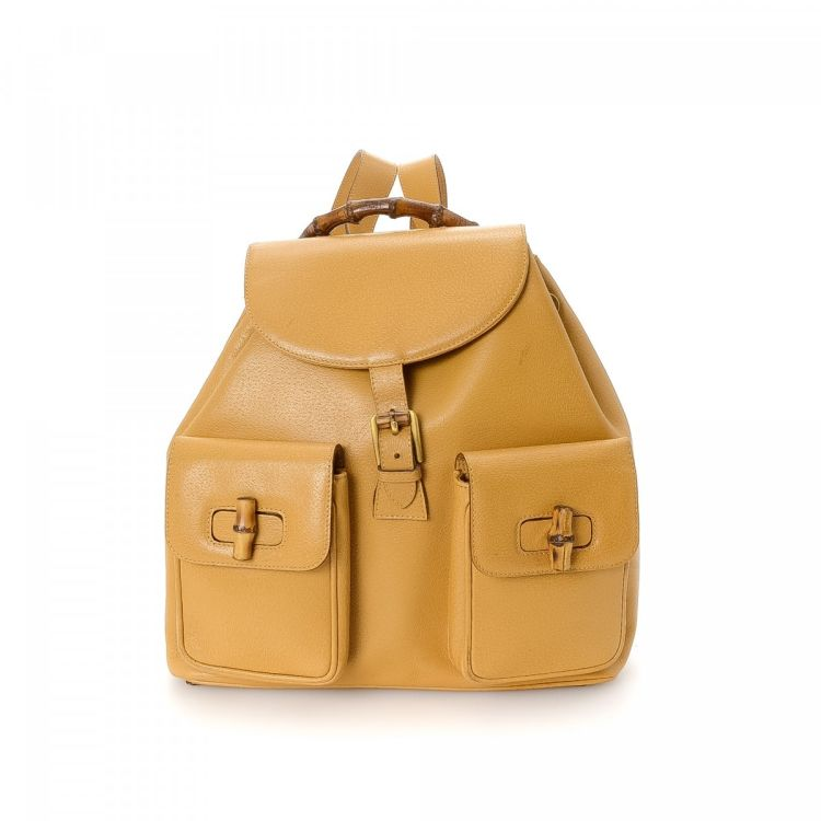 fb7e4dc99795 LXRandCo guarantees this is an authentic vintage Gucci Bamboo backpack.  This chic backpack comes in tan leather. Good condition  (AB)