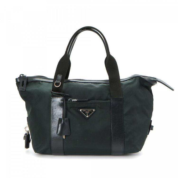 676677f467ea LXRandCo guarantees the authenticity of this vintage Prada handbag. This  elegant handbag was crafted in tessuto nylon in dark green.