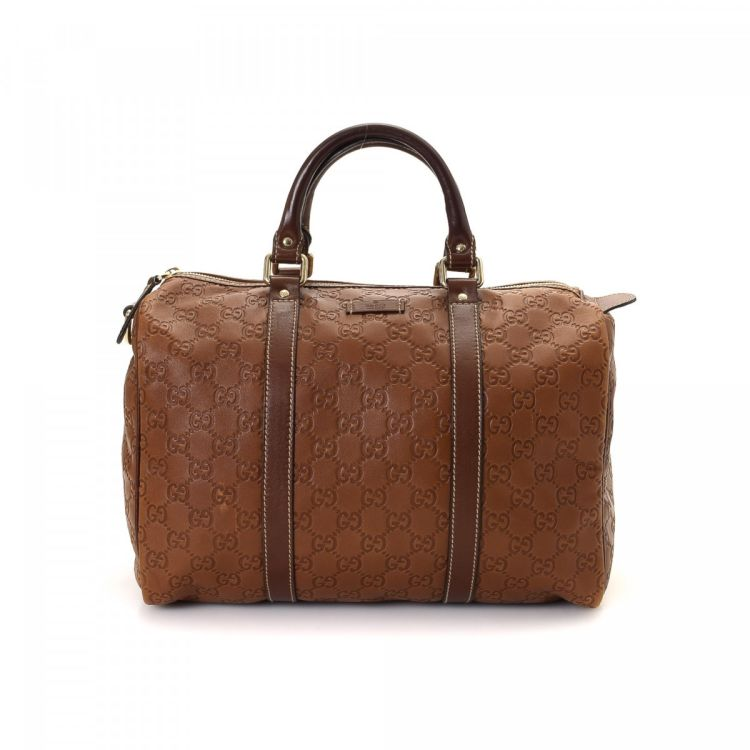 be287c08fb15 LXRandCo guarantees the authenticity of this vintage Gucci Joy Boston Bag  travel bag. Crafted in guccissima leather, this refined weekender comes in  brown.