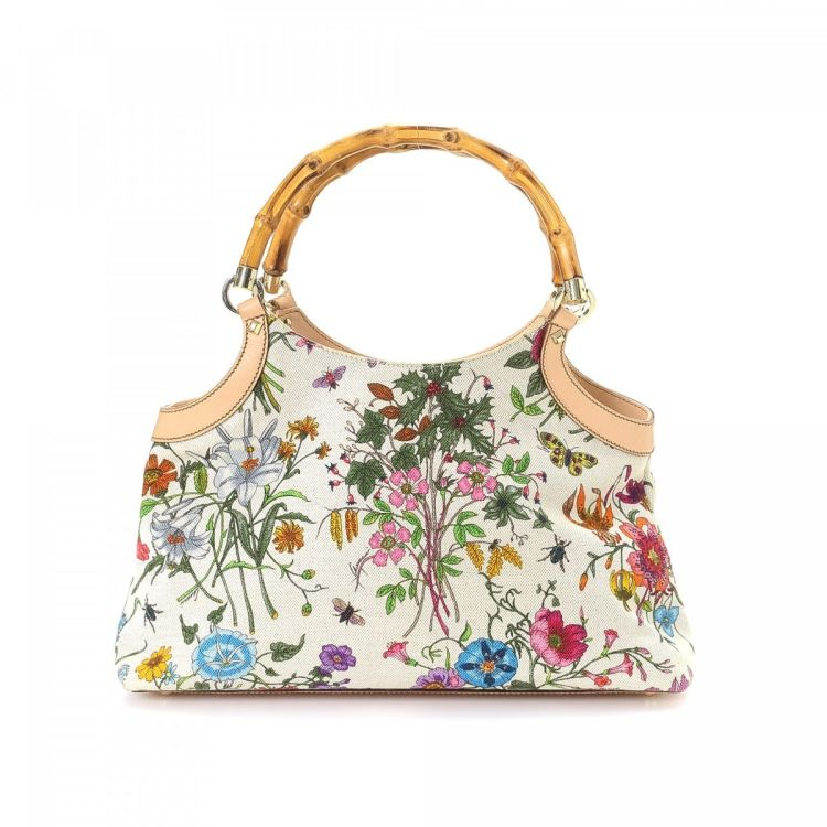 614d161e054e LXRandCo guarantees this is an authentic vintage Gucci Bamboo shoulder bag.  This iconic pocketbook in beautiful multi color is made in flora canvas.