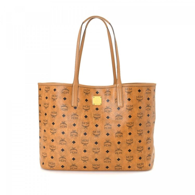 9070a9aad66c LXRandCo guarantees this is an authentic vintage MCM Leopard Print  Reversible tote. Crafted in visetos coated canvas, this elegant tote comes  in cognac.