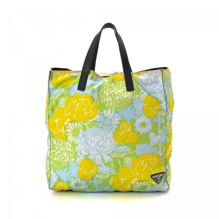 05930ee718f2 LXRandCo guarantees this is an authentic vintage Prada Floral Bag tote.  This stylish tote was crafted in tessuto nylon in beautiful multi color.