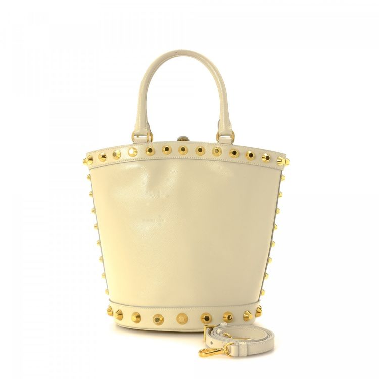 17efa5b7042097 LXRandCo guarantees this is an authentic vintage Prada Studded Two Way Bag  shoulder bag. This lovely bag in white is made in vitello leather.